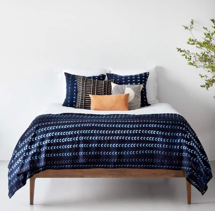 Bed throw + matching pillows:  a classic option, you just can't go wrong with it